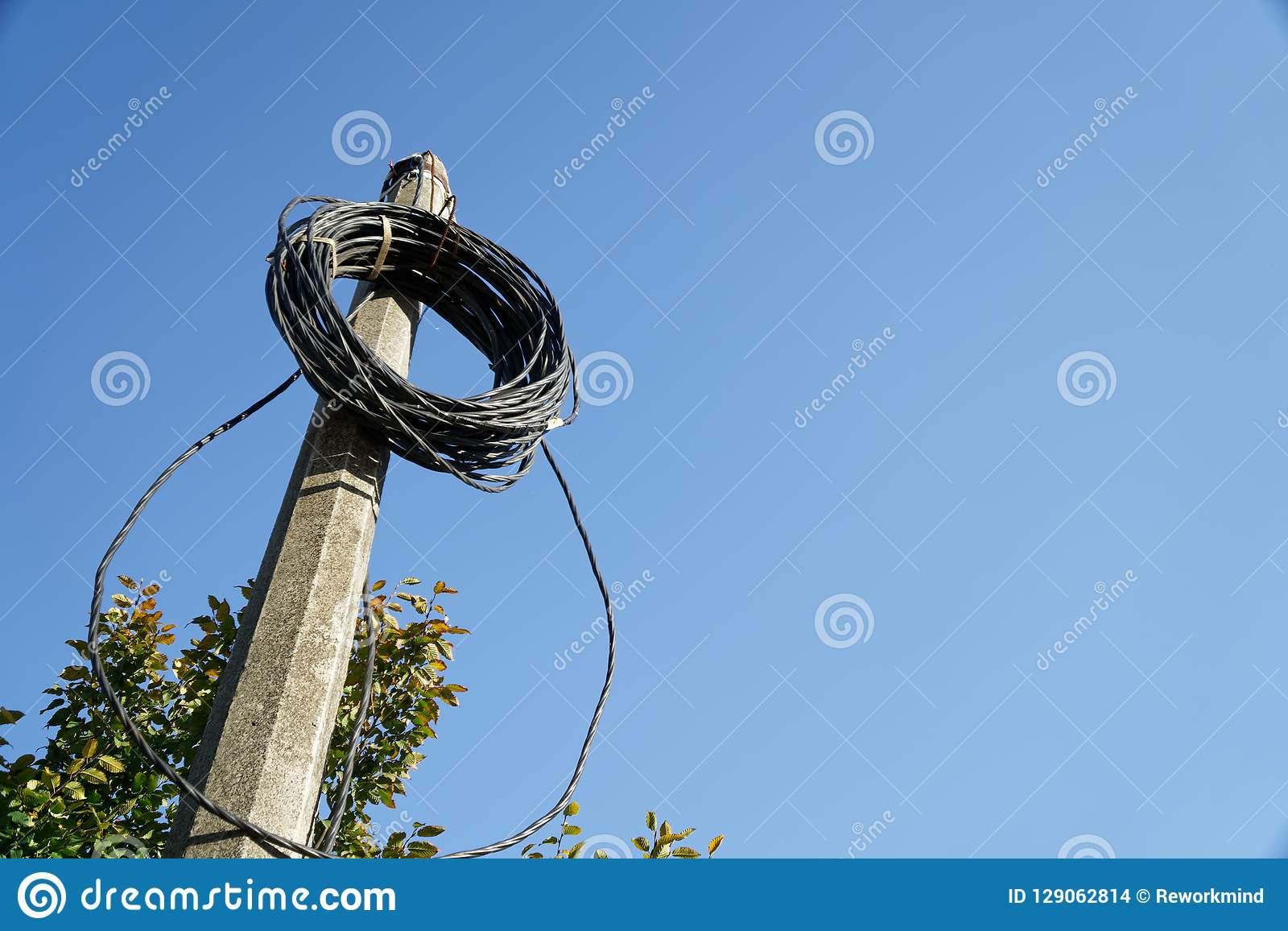 Electric wires rolled on post, bind cable