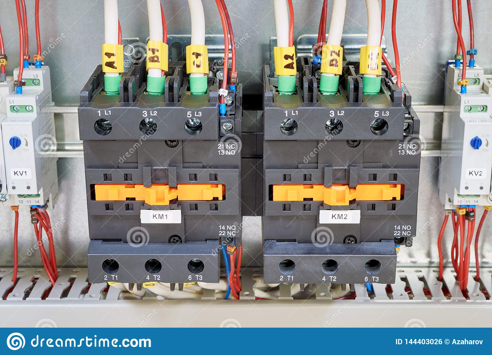 electrical cables and wires are connected to two powerful magnetic starter  or contactor  on the sides of the modular time relay with adjustment