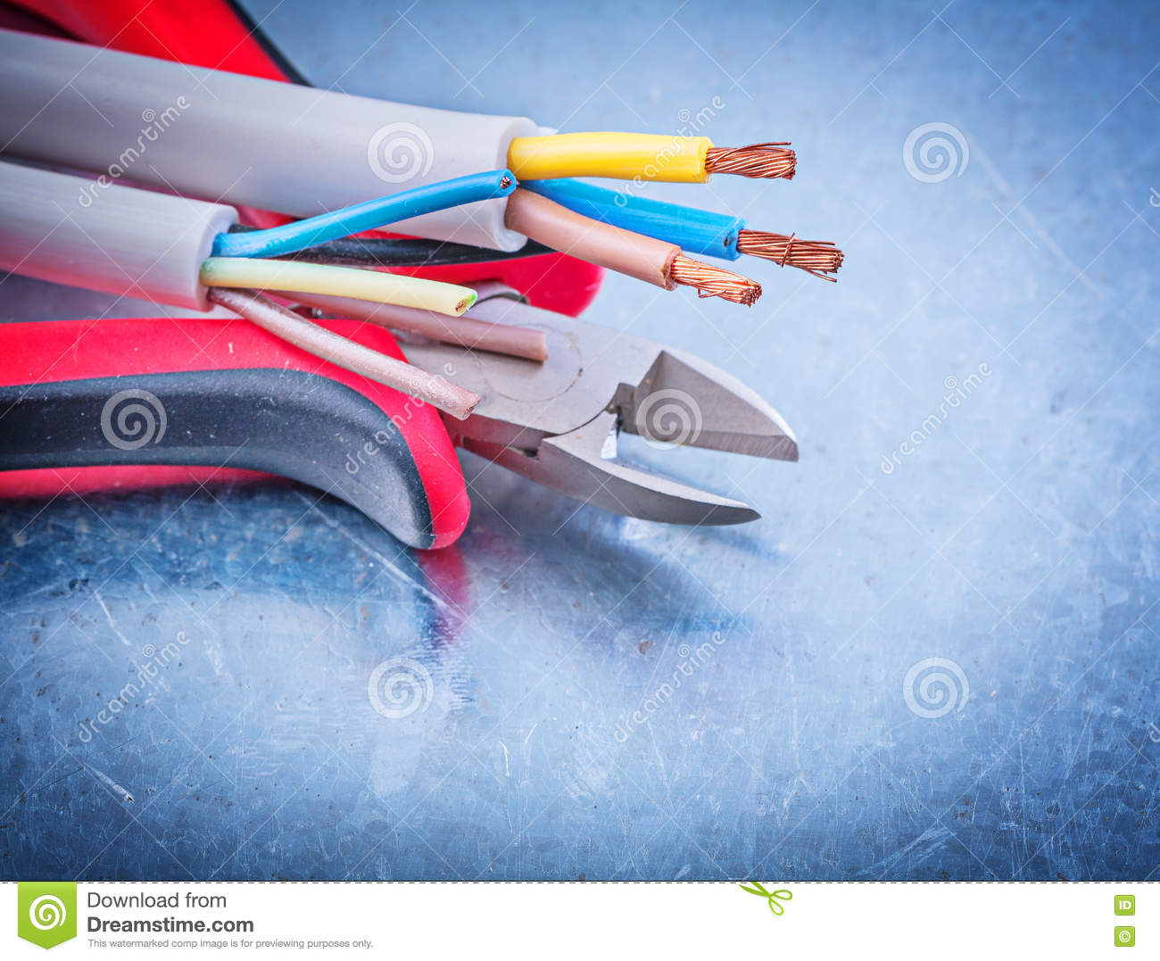 Electrical cables wires cutting pliers on metallic background co