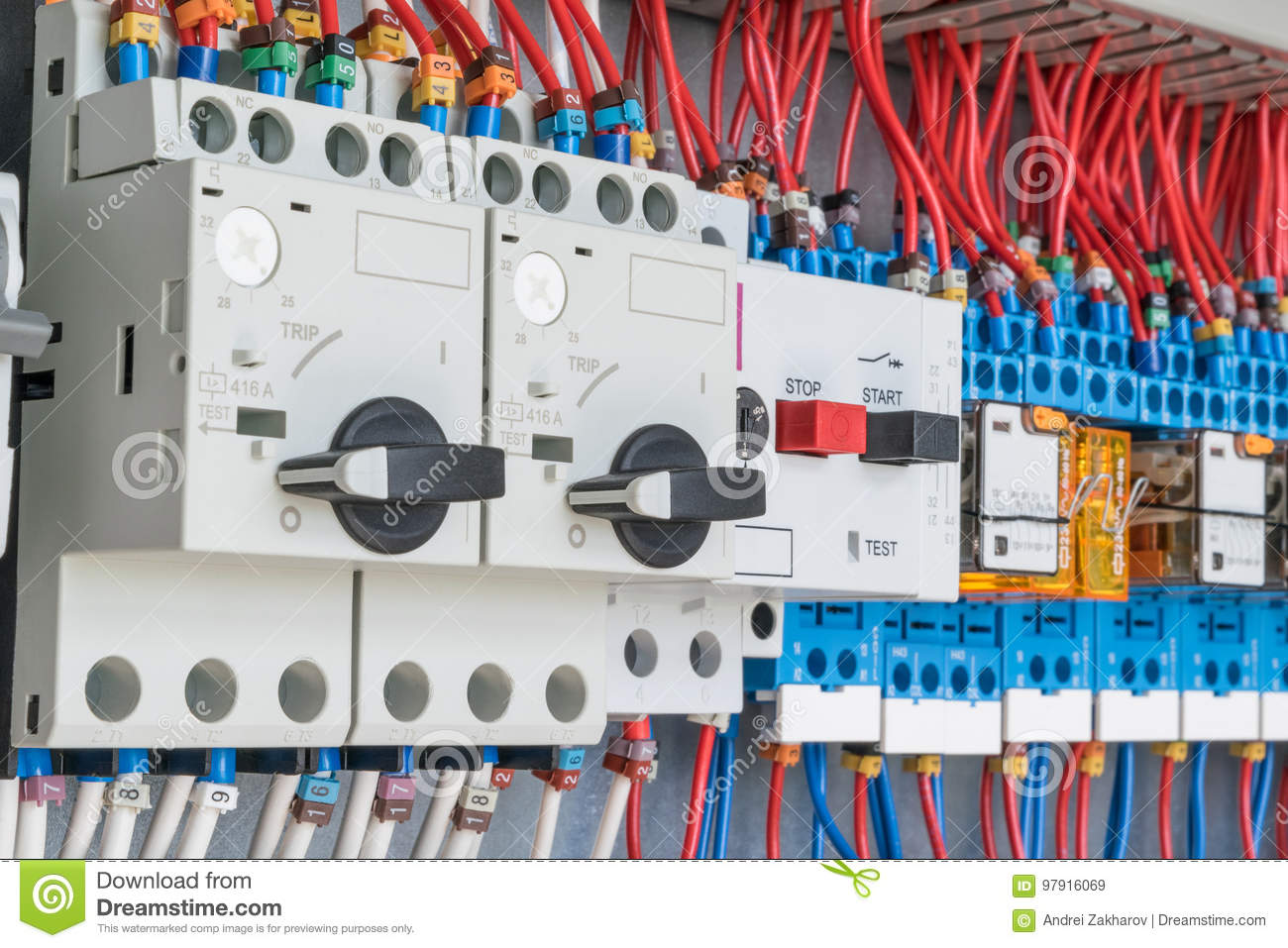 In the electrical control panel are circuit breakers protecting the motor and relay.