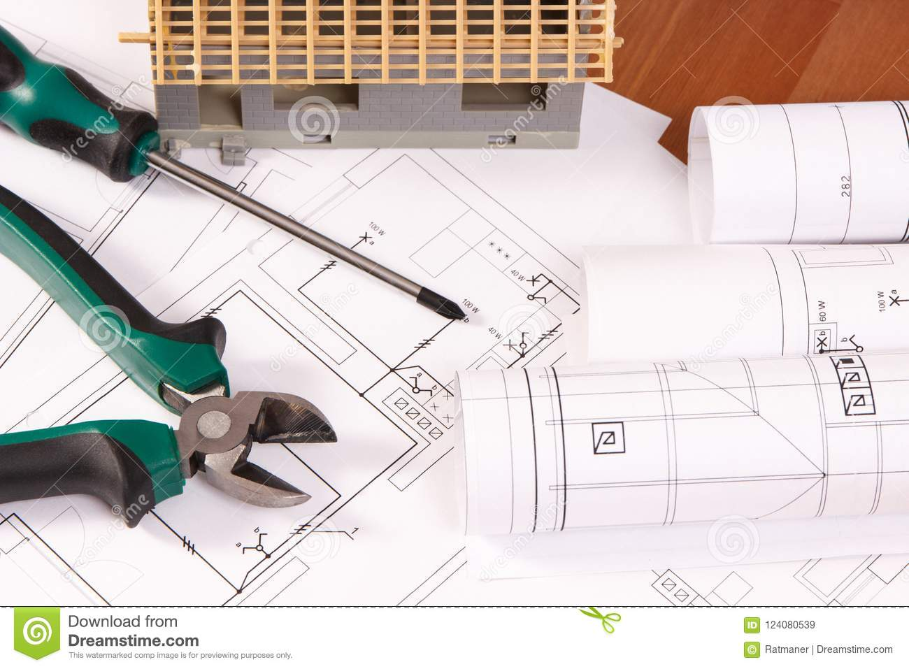 Electrical drawings work tools and house under construction lying electrical drawings or diagrams work tools and house under construction lying on desk building home concept ccuart Image collections
