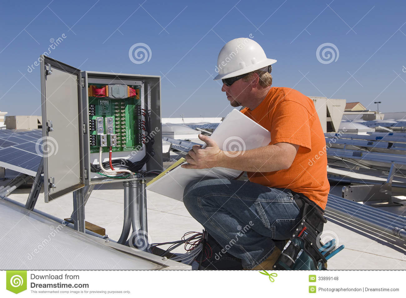 Electrical Engineer Holding Book While Analyzing Electricity Box Engineering Books