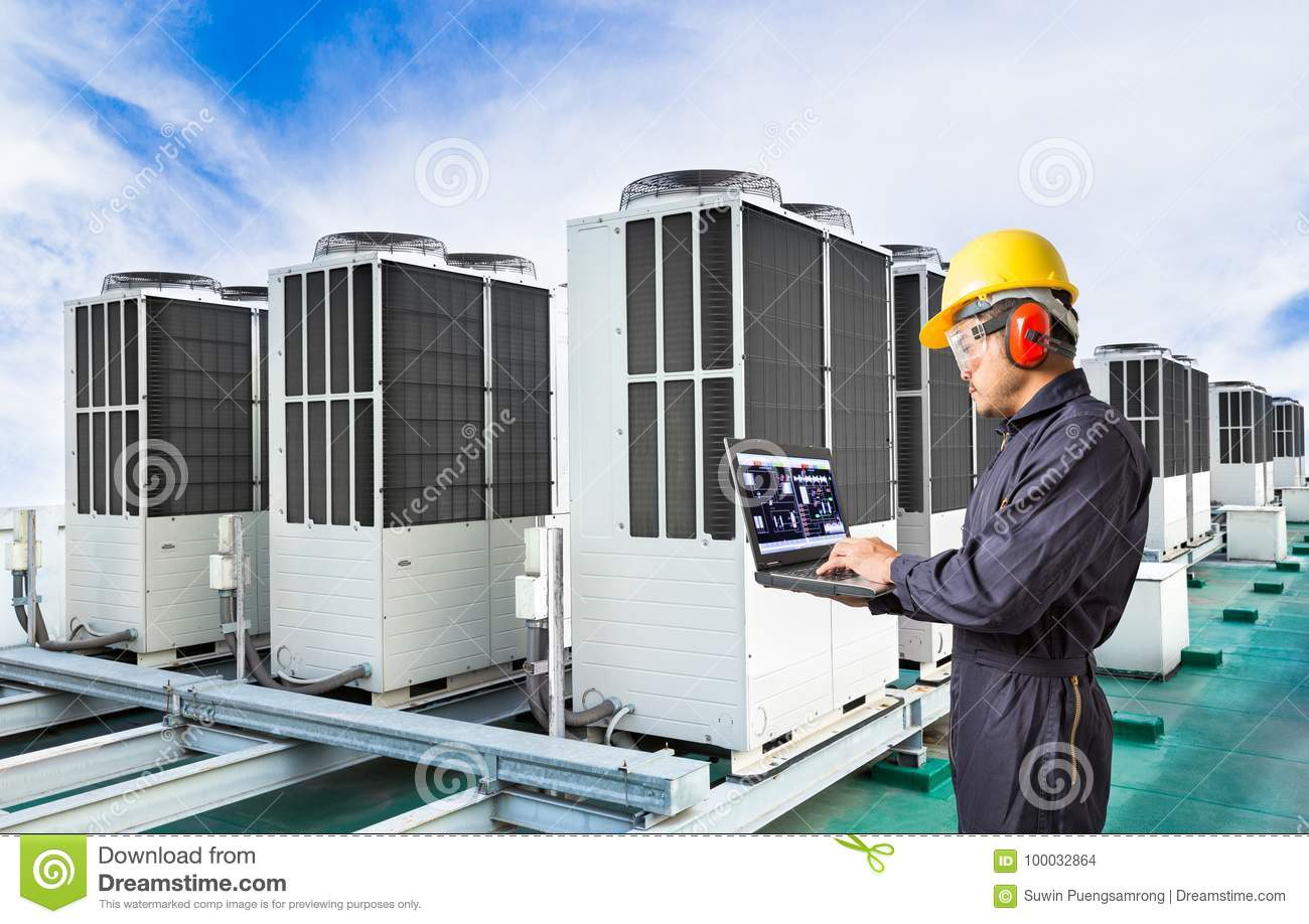 Electrical engineer using laptop computer for maintenance air