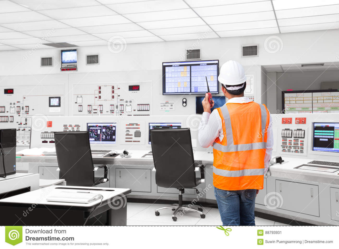 Electrical engineer working at control room of thermal power plant