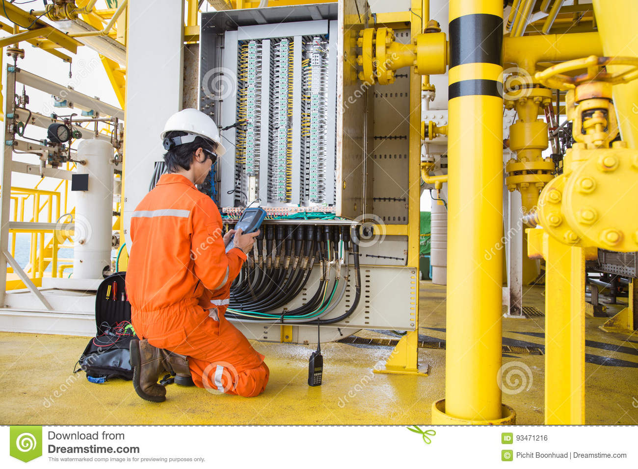 Electrical and instrument technician maintenance electric system at offshore oil and gas processing platform.