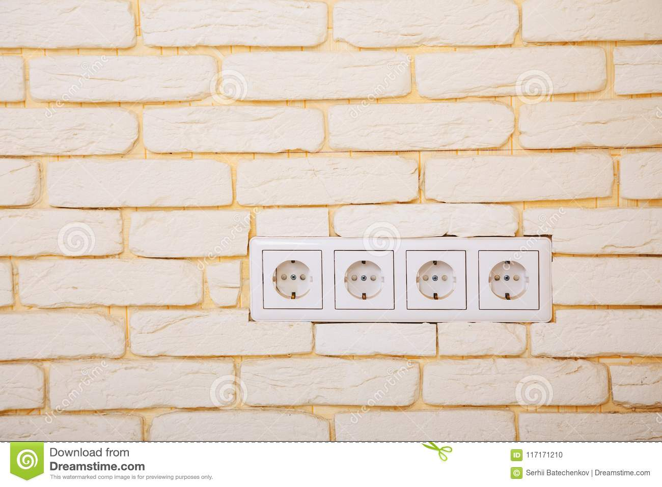 Electrical Outlets Or Network Sockets In The Brick Wall Stock Photo ...