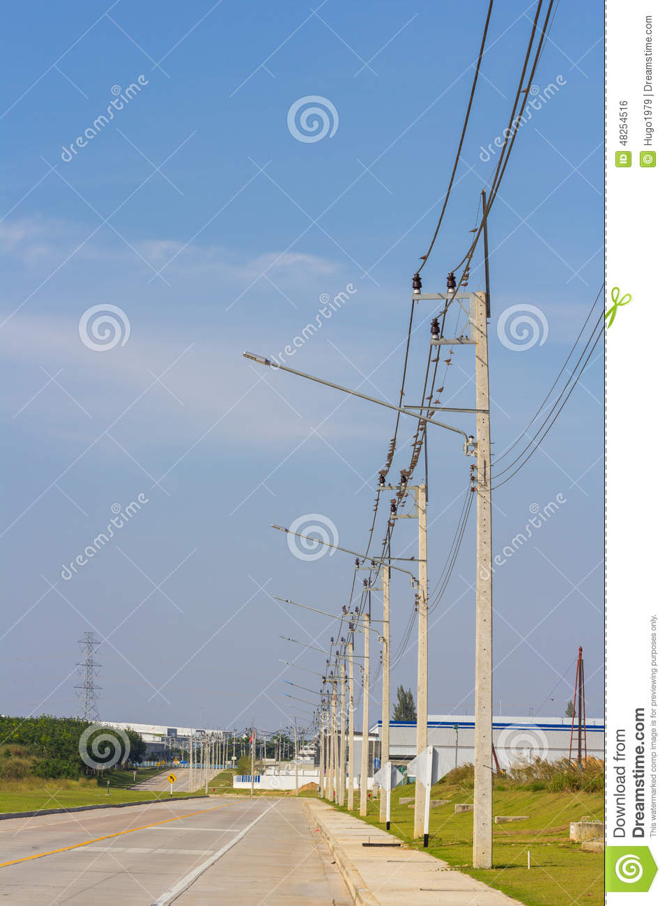 electrical post with power cable and street light stock photo