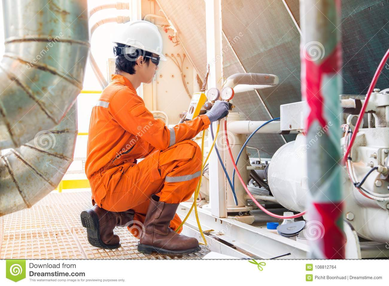 Download Electrical Specialist Checking Heating Ventilation And Air Conditioning System HVAC For Preventive Maintenance. Stock Photo - Image of equipment, electrical: 108812764