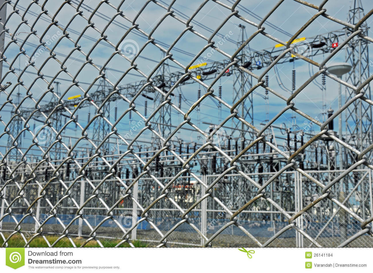 Electrical Substation Behind Wire Chain Fence Stock Photo