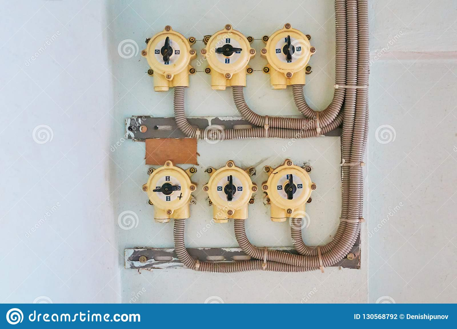 Electrical Switches On A White Plaster Wall With Connected Wires Wiring