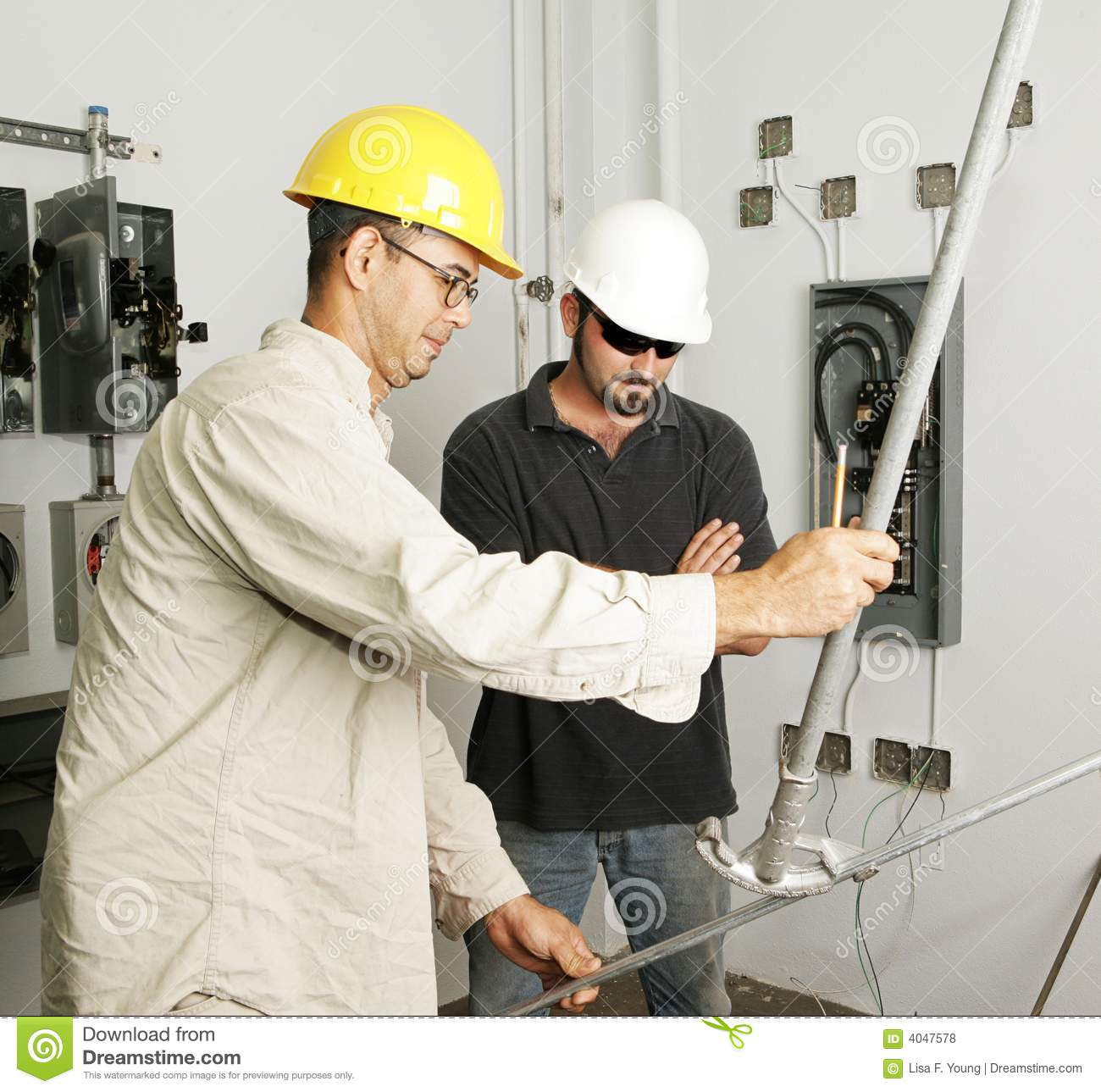 electrical team bending pipe royalty free stock photos