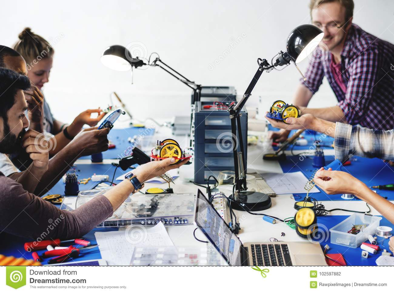 Electrical technicians working on robot electronics parts