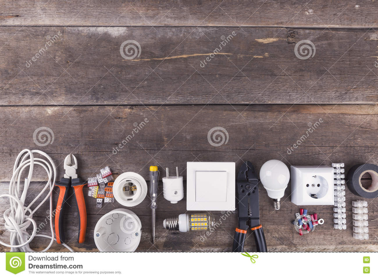 Electrical tools and equipment on wooden background with copy sp