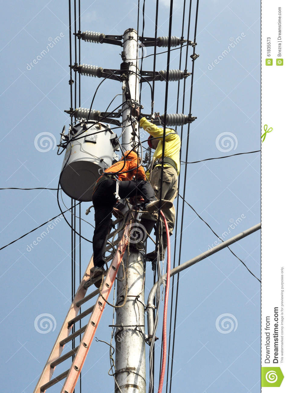 Electrical Worker Repairing The Installation Stock Photo