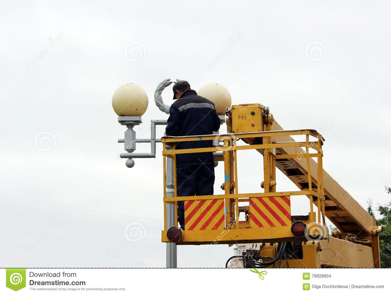 Electrical Worker Repairing The Wires On The Pole With The ...