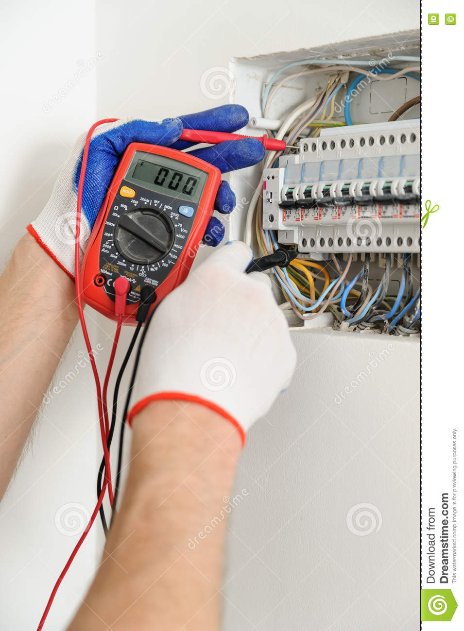 electrician check voltage electrical fuse box multimeter 74989274 electrician check voltage in electrical fuse box stock photo how to check fuse box with multimeter at gsmx.co