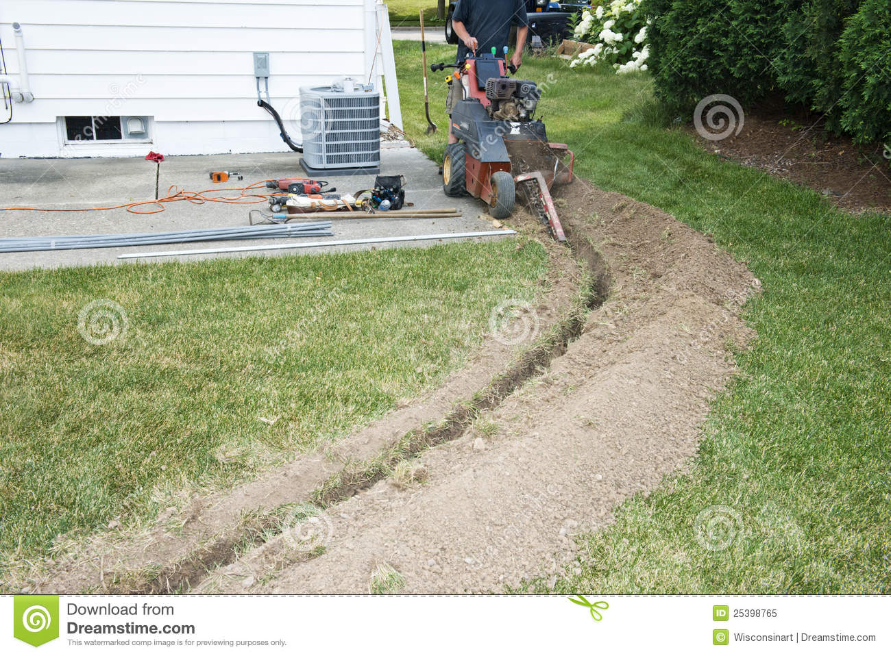 Electrician Contractor Dig Trench For Electrical Stock Image