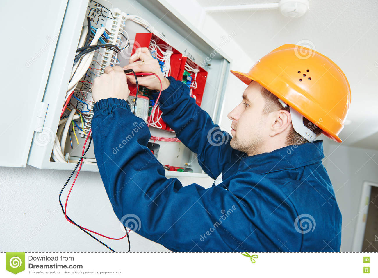 Electrician examining current voltage with screwdriver tester