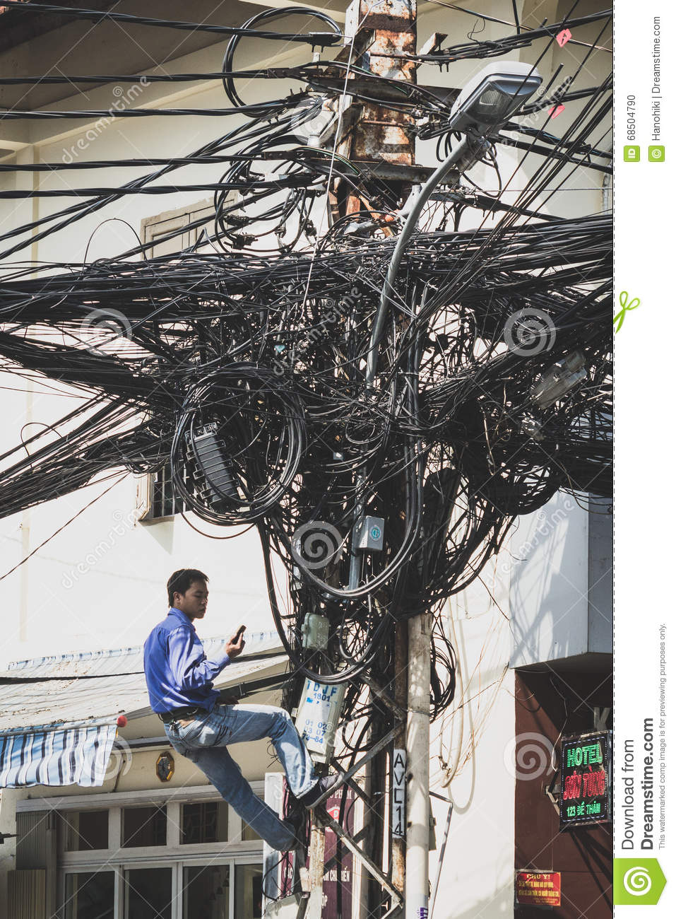 Admirable Electrician Fixing Messy Cables Communication Network Editorial Wiring 101 Mecadwellnesstrialsorg
