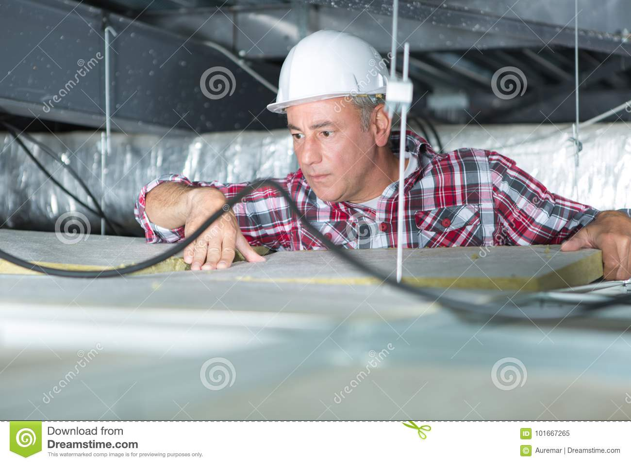 Electrician fixing neon on ceiling
