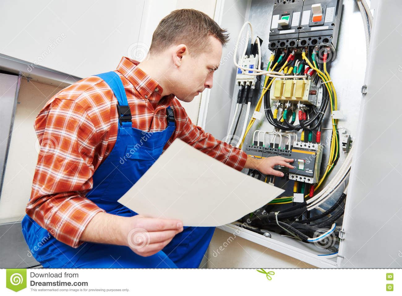 electrician hand test voltage screwdriver electric checking switching electric actuator equipment fuse box 82177868 electrician hand with test voltage screwdriver stock photo image how to test voltage at fuse box at eliteediting.co