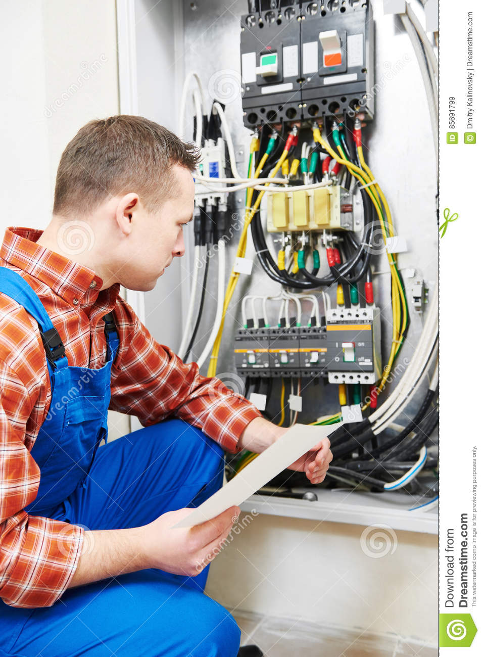 electrician hand test voltage screwdriver electric checking switching electric actuator equipment fuse box 85691799 electrician hand with test voltage screwdriver stock photo image how to test voltage at fuse box at eliteediting.co