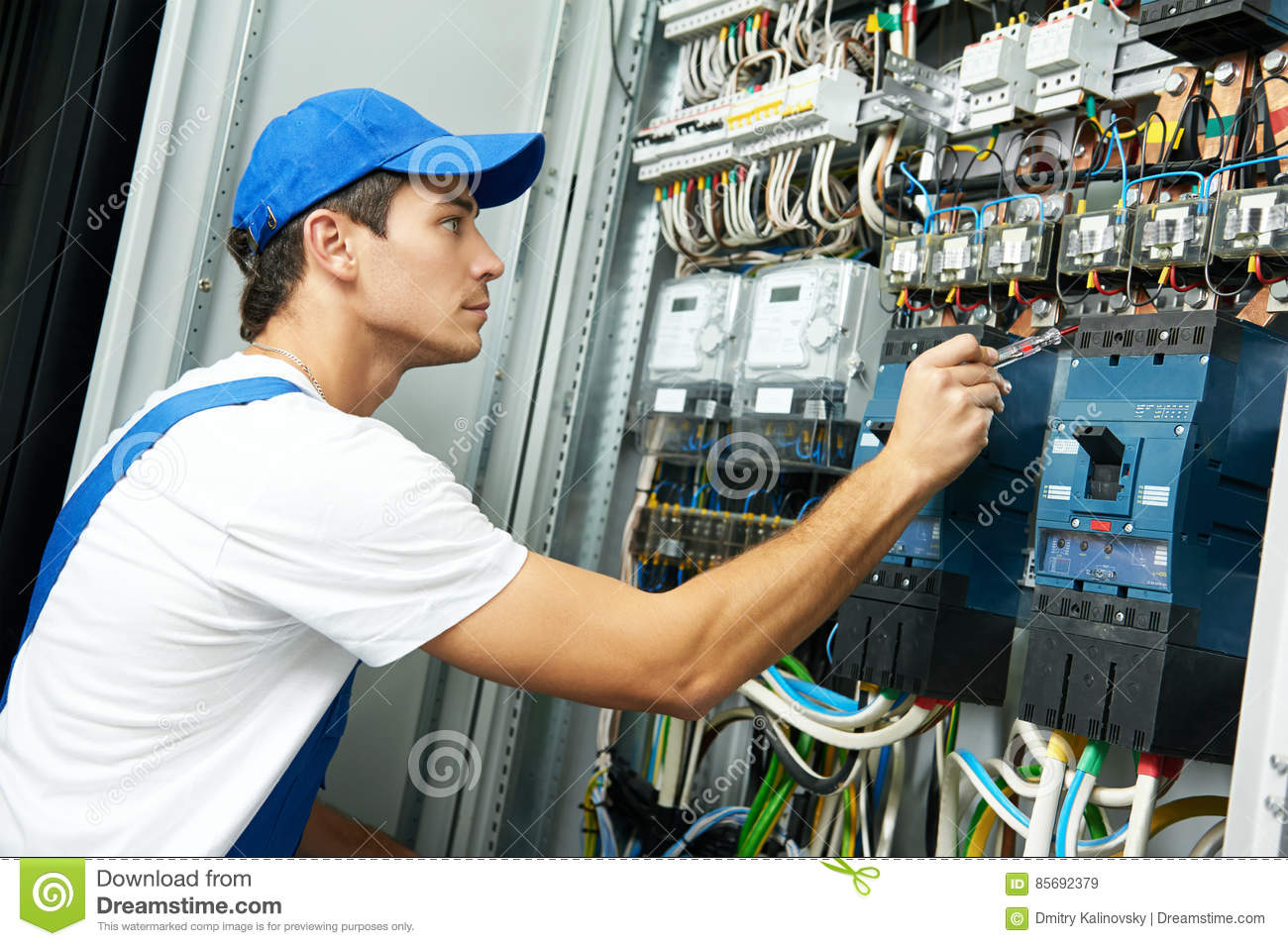 electrician hand test voltage screwdriver electric checking switching electric actuator equipment fuse box 85692379 electrician hand with test voltage screwdriver stock photo image how to test voltage at fuse box at eliteediting.co