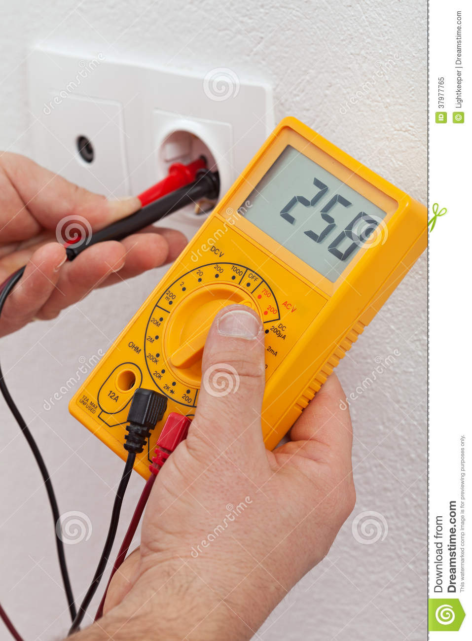 electrician hands measuring voltage in electrical outlet royalty free stock photo image 37977765. Black Bedroom Furniture Sets. Home Design Ideas