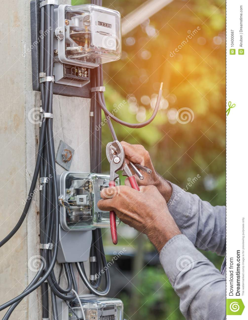 Electrician Installing Electric Meter For Measuring Power Into Wiring A Fuse Board Line Distribution Fuseboard