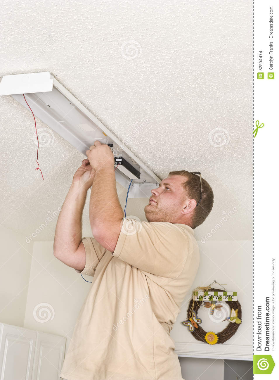 Electrician Installing Fluorescent Lighting Ballast Stock