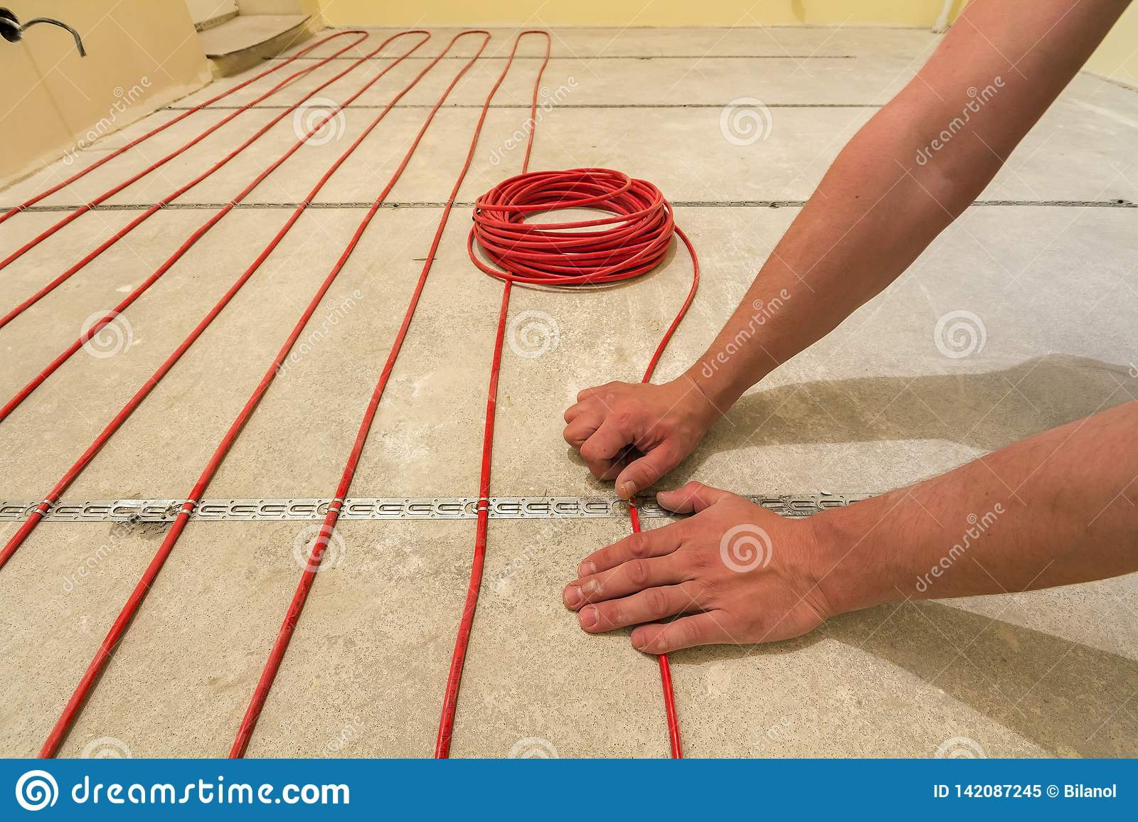 Pleasing Electrician Installing Heating Red Electrical Cable Wire On Cement Wiring Digital Resources Timewpwclawcorpcom