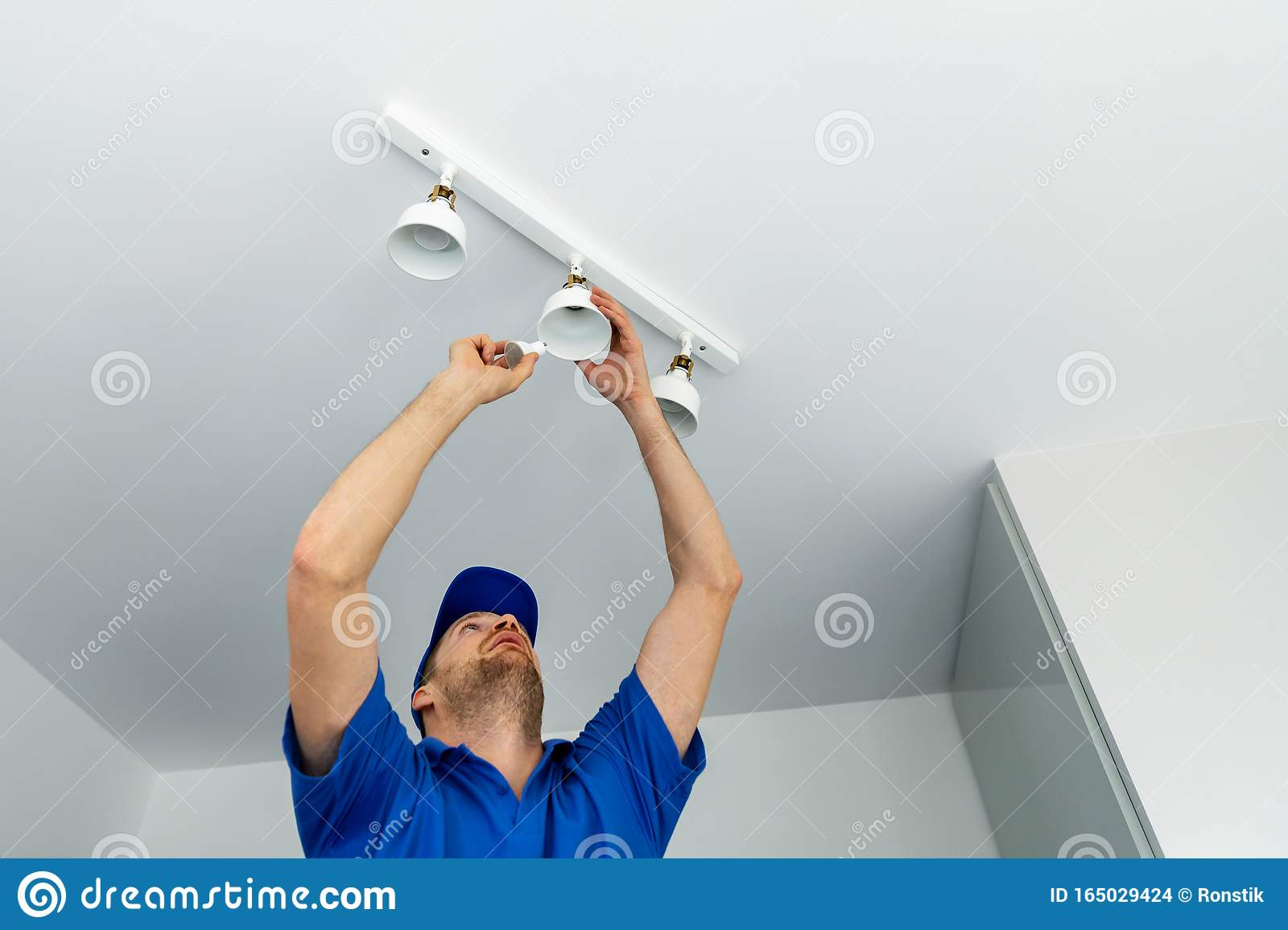 Electrician Installing Led Light Bulbs In Ceiling Lamp Stock Photo Image Of Equipment Occupation 165029424