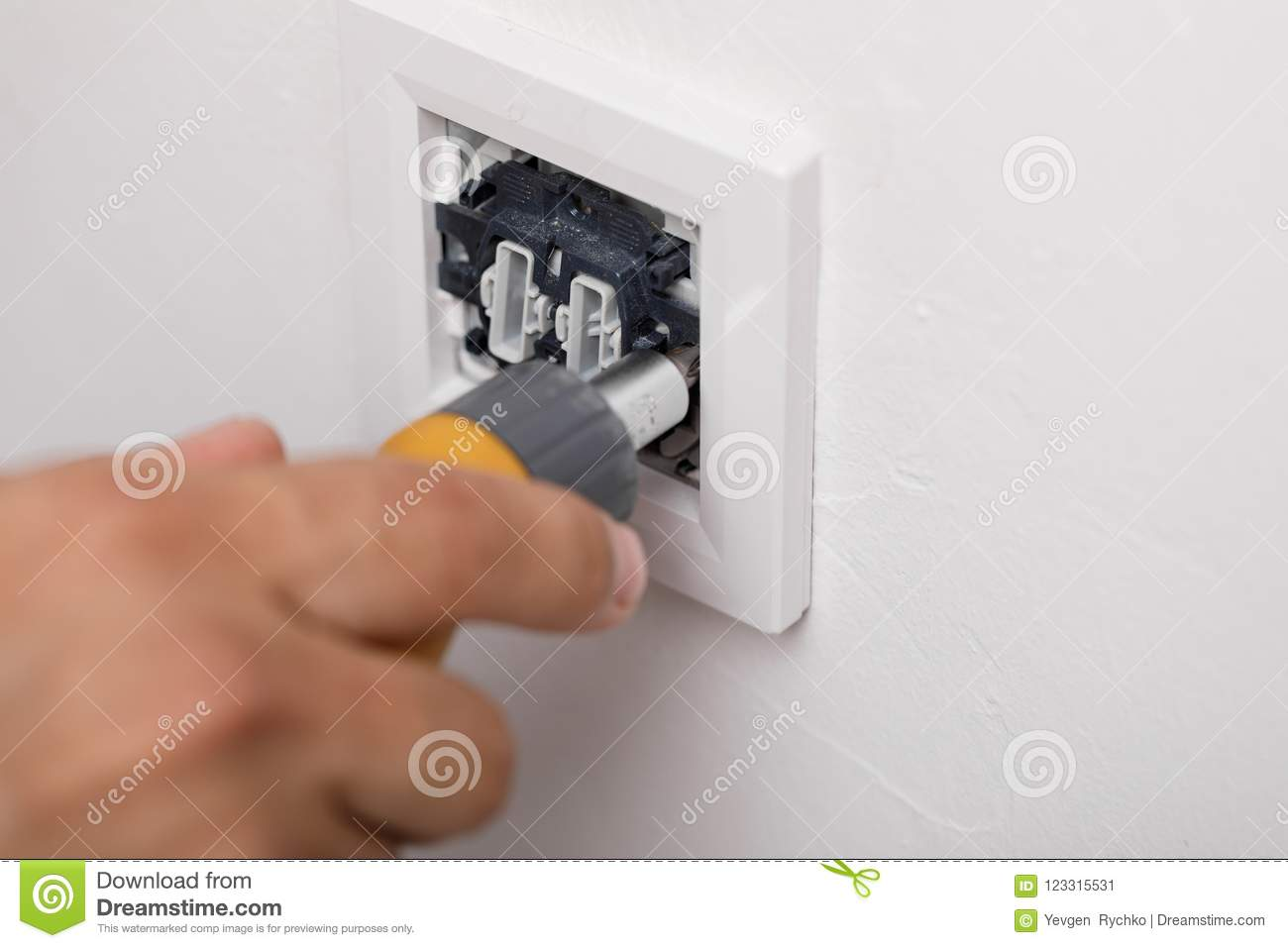 The Electrician Installing The Light Switch. Tool Stock Image ...