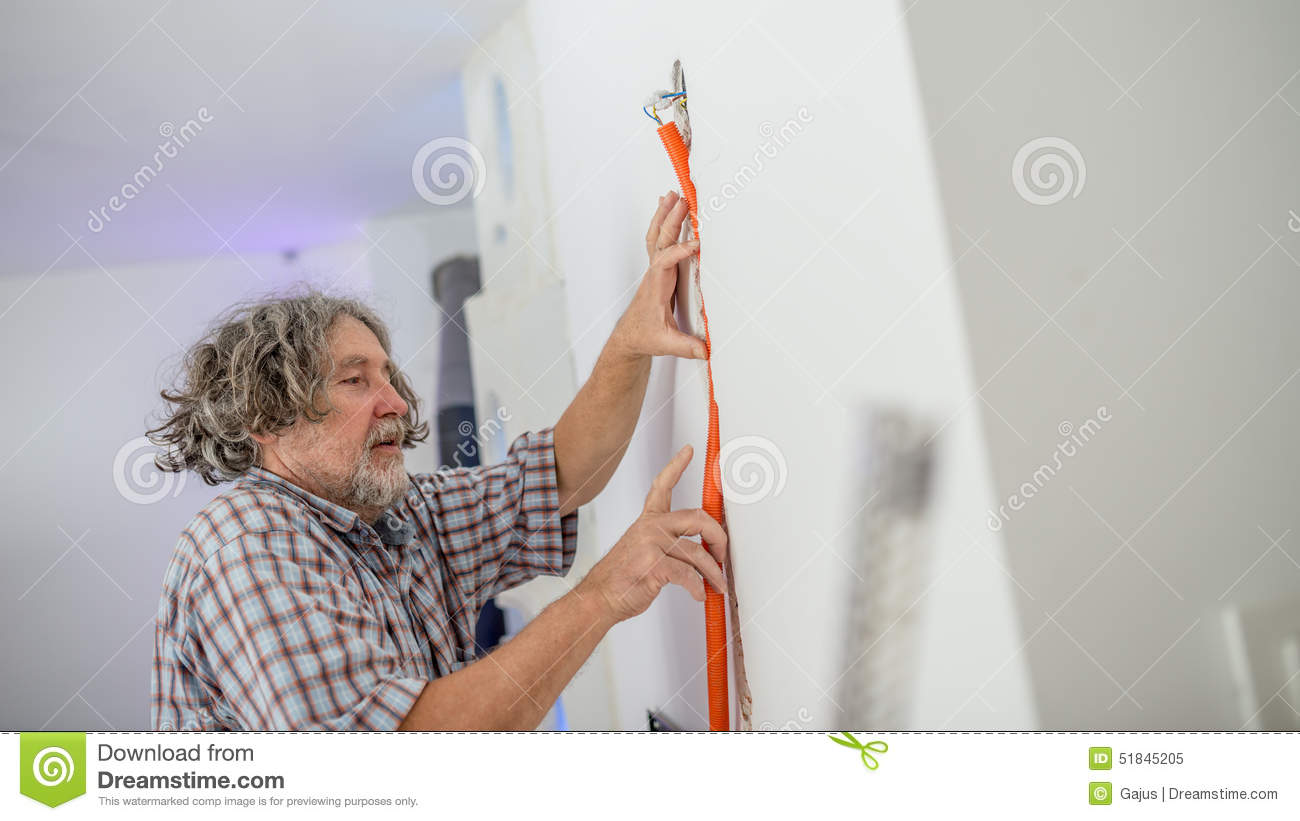 Electrician Installing Wiring In A Wall Stock Image Of Receptacle