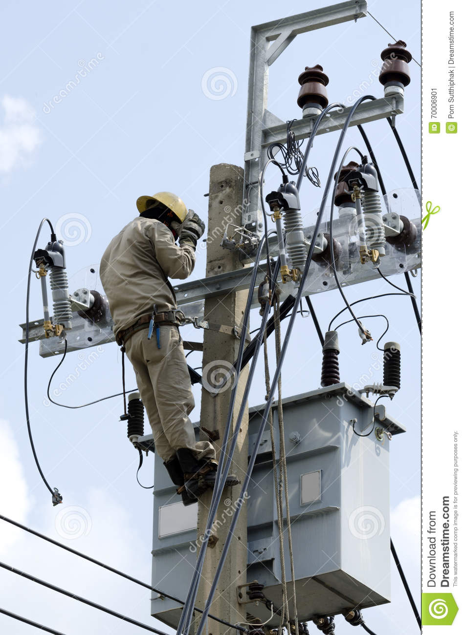 Electrician Lineman At Climbing Work On Electrical Power Pole ...