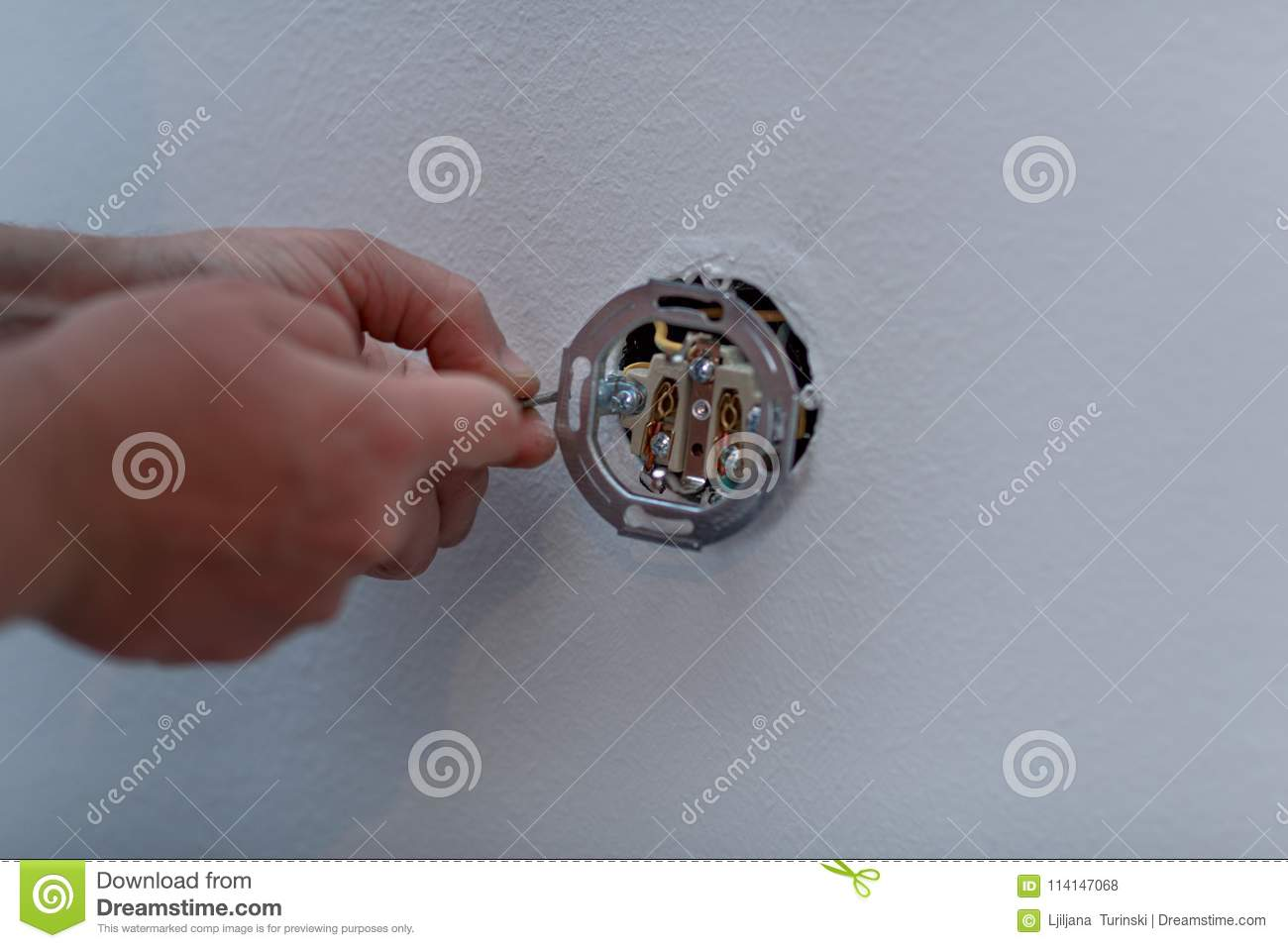 Electrician At Work On Switches And Sockets Of A Residential Ele ...