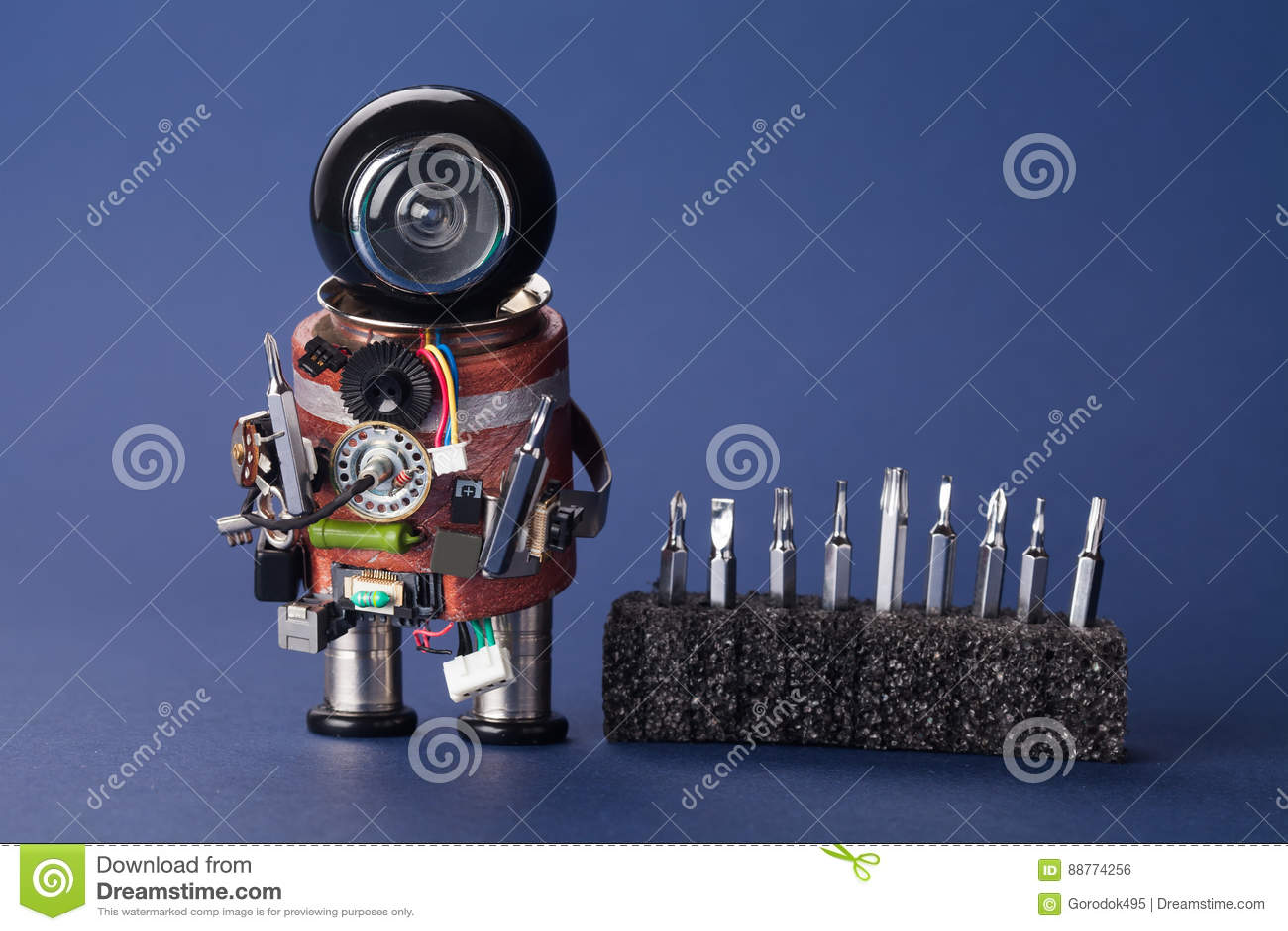Electrician robot with screwdriver set. Fun service character, black helmet head and handyman instrument. Macro view
