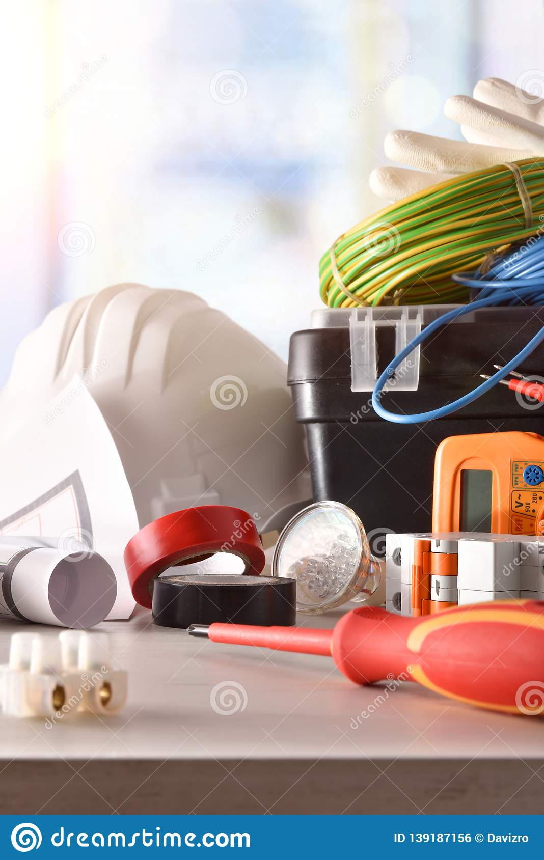 Electrician`s office table with electrical equipment window background vertical composition