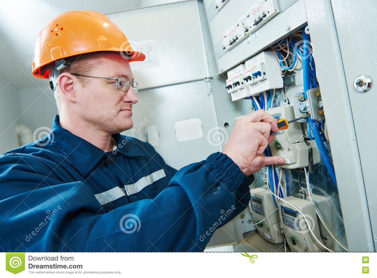 Electrician With Screwdriver Repair Switching Electric Actuator In Fuse Box Download Stock Photo Image Of