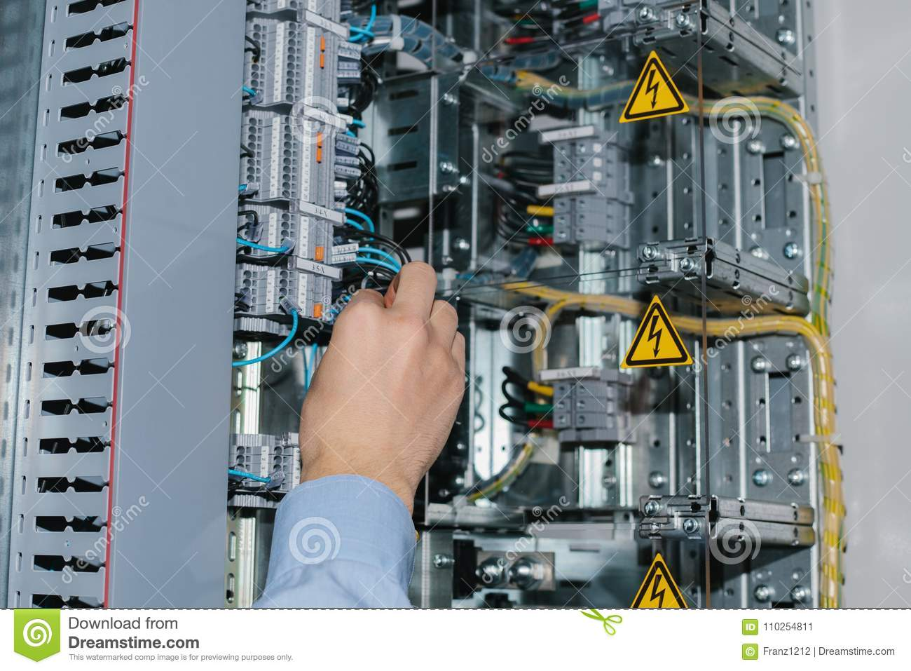 Electrician Specialist Checking Low-voltage Cabinet Equipment Stock
