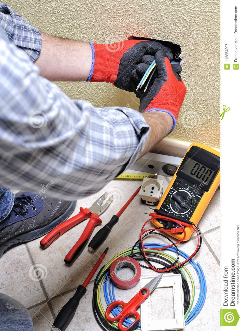 Electrician Technician At Work With Safety Equipment On A