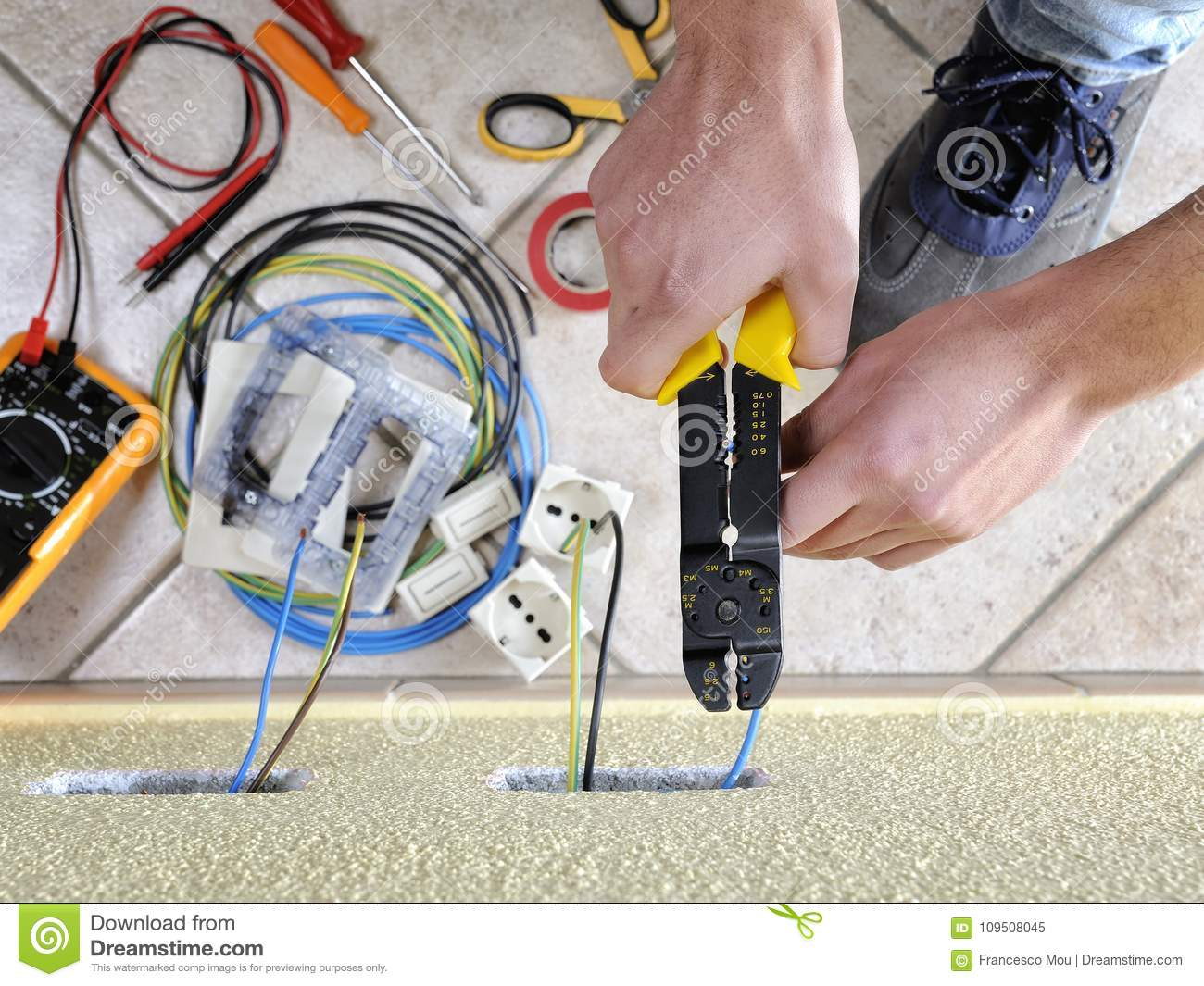Pleasing Electrician Technician At Work On A Residential Electric System Wiring Database Ioscogelartorg