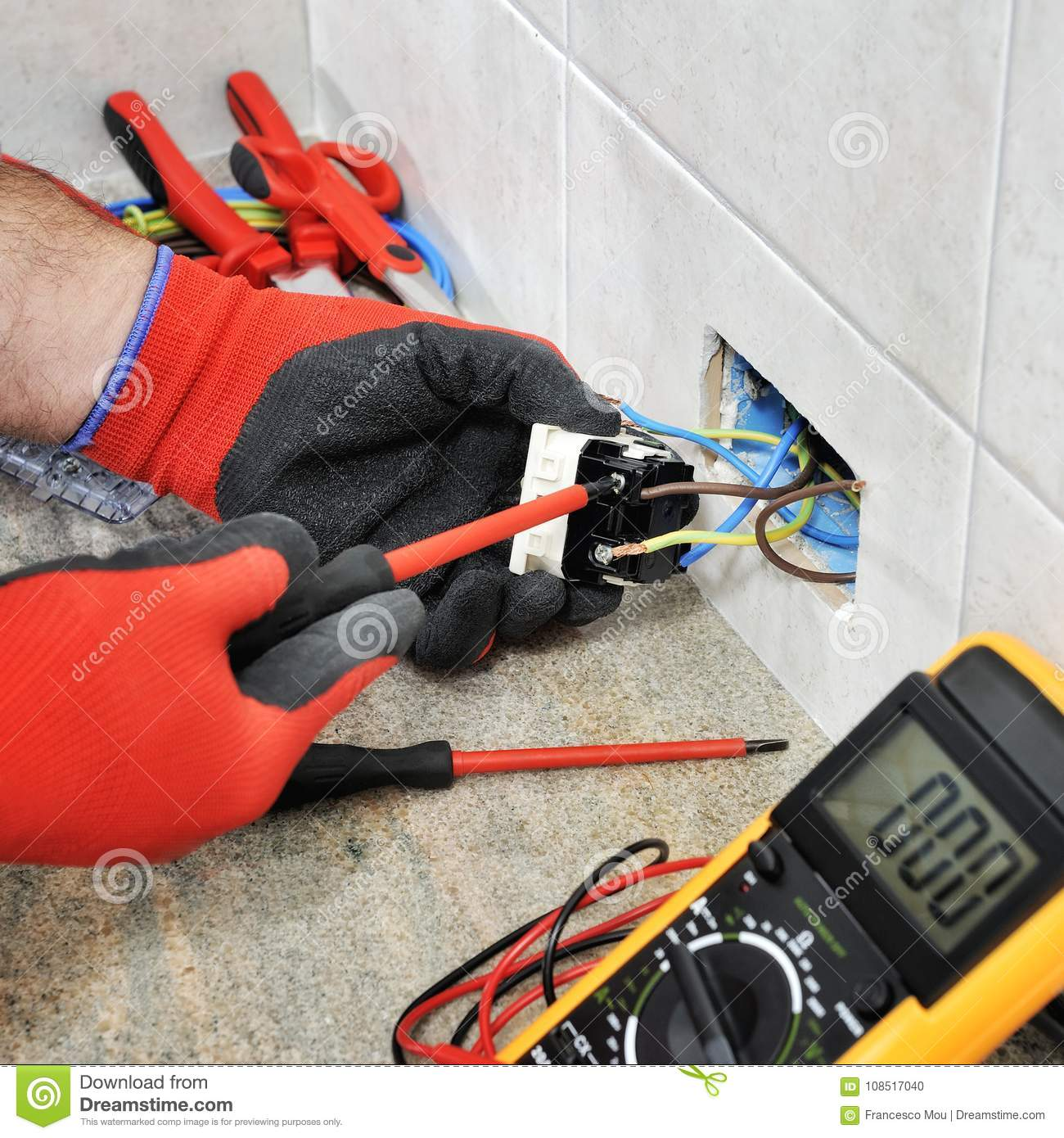 Electrician Technician Working Safely On A Residential Electrical Electric Wiring System
