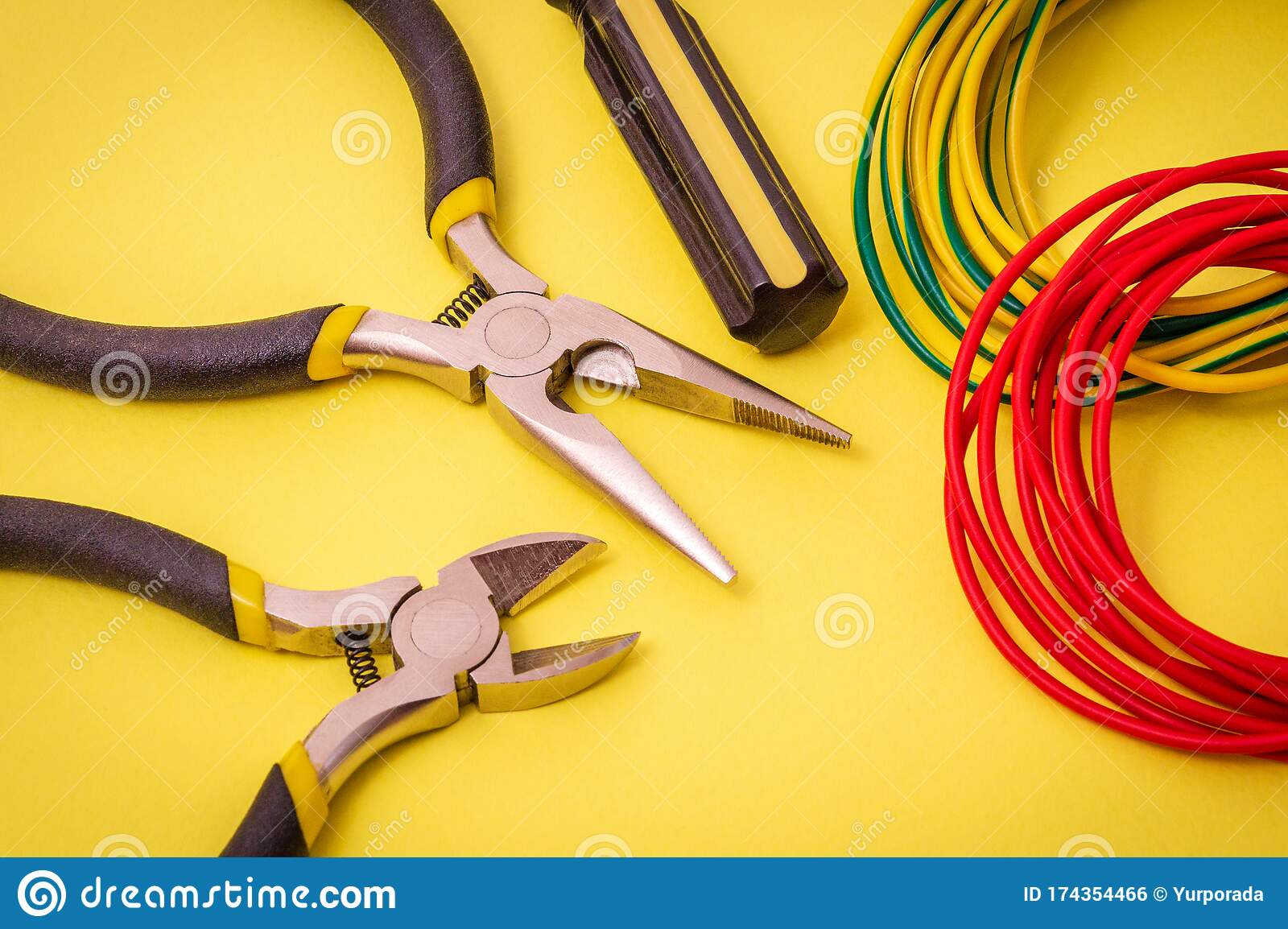 Electrician Tools And Wires On Yellow Background For Repairing Energized Systems Or Communications Stock Photo Image Of Yellow Repair 174354466