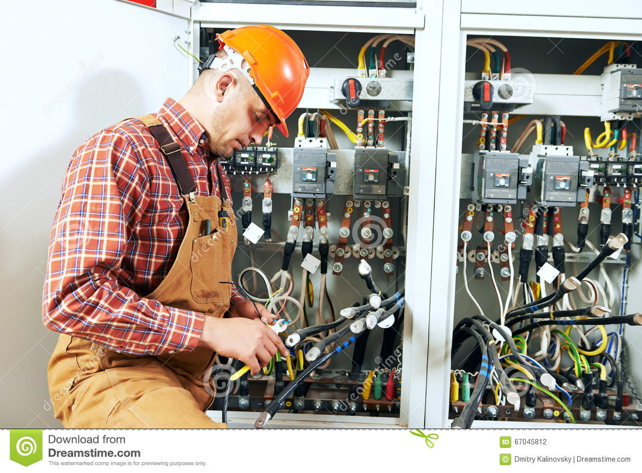 Electrician at wiring work stock photo. Image of embling ... on wiring contractors, clutch works, electronics works, floor works, painting works, fabrication works, pump works, motor works,