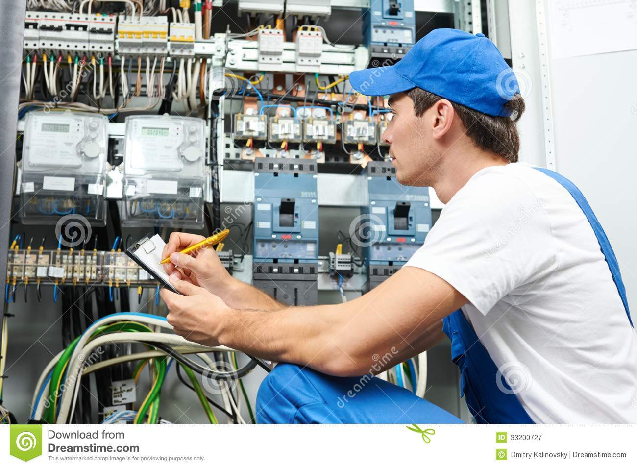 electrician worker inspecting stock image