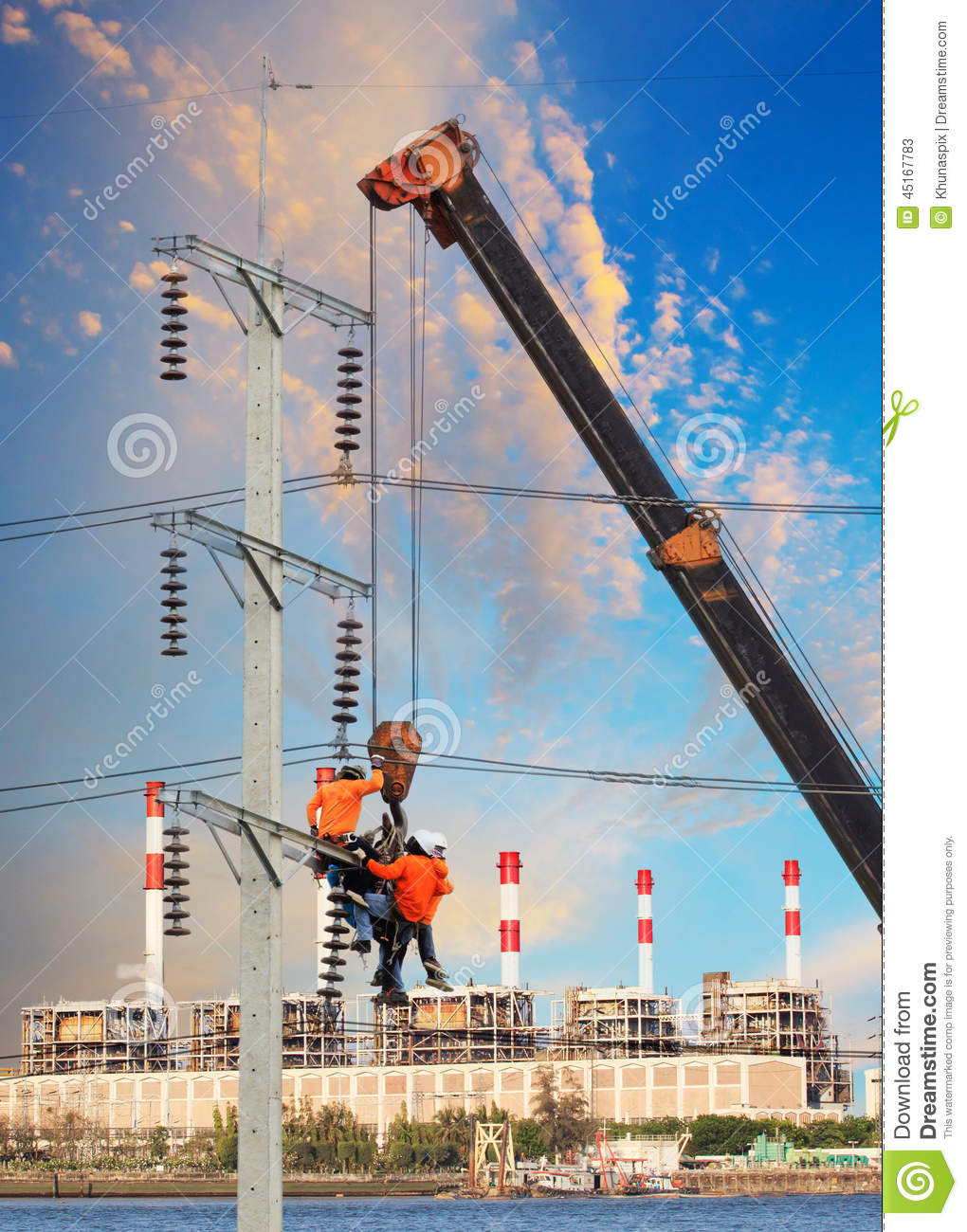 Electrician Worker Working On High Voltage Electric Pole With Cr ...