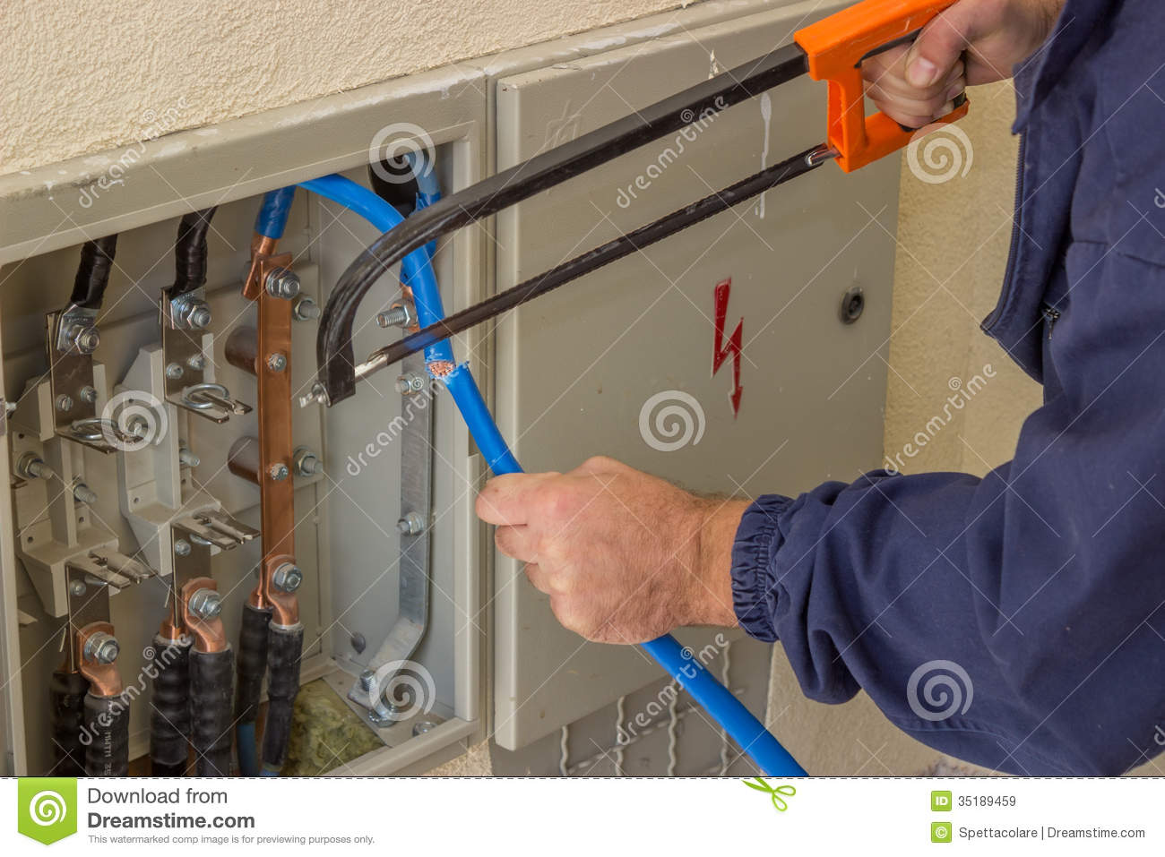 Three Phase Fuse Box Wiring Diagram House Libraryelectrician Working With A Chainsaw In The Electrical Cabinet