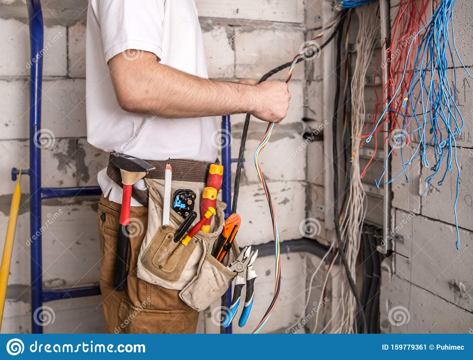 Electrician Working Near The Board With Wires Installation And Connection Of Electrics Stock Image Image Of Phase Bunch 159779361