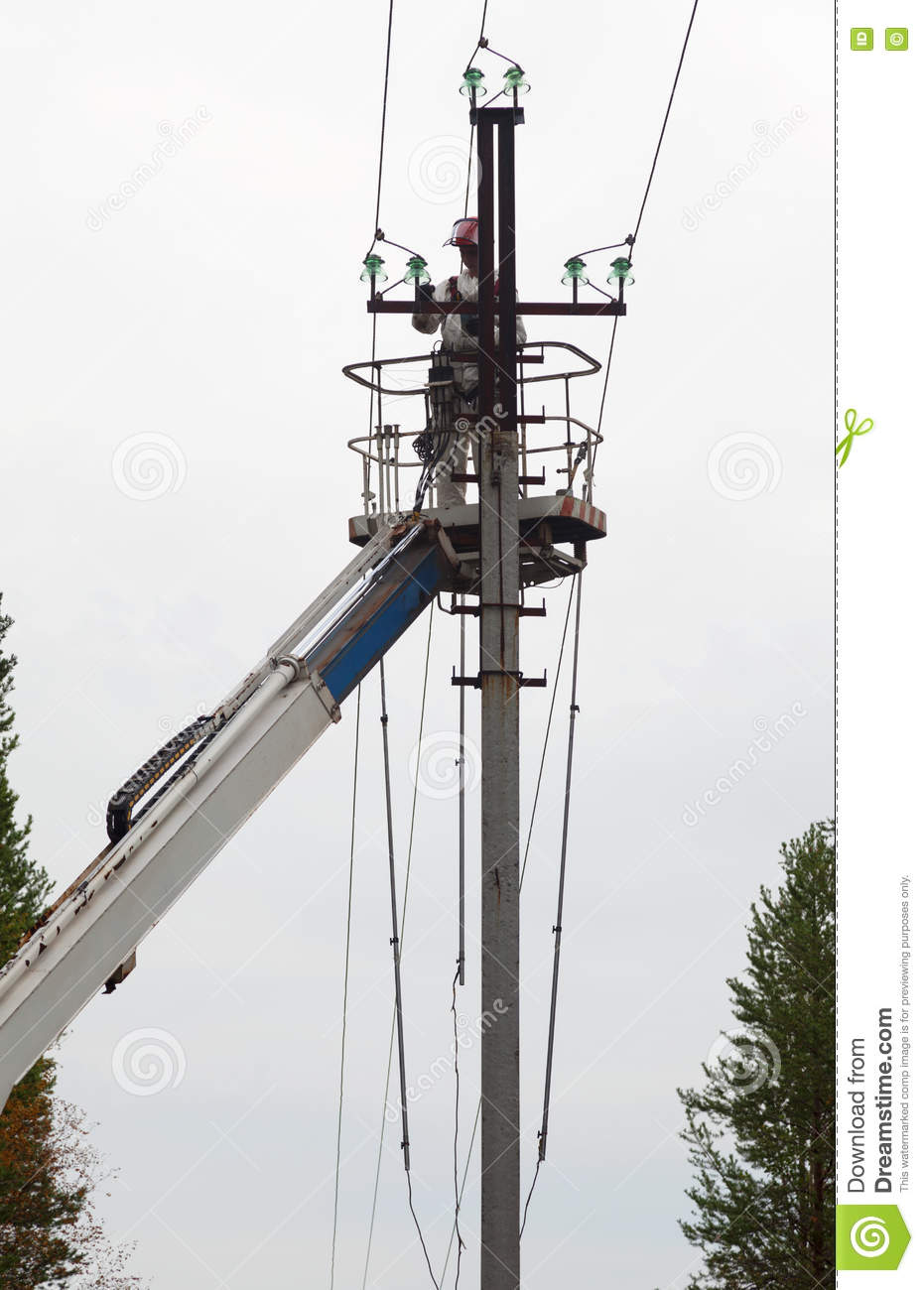 Electrician Working At A Pillar Stock Image - Image of